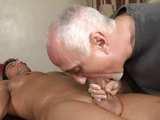 mature homosexual hunk sucks younger hard pecker on massage table
