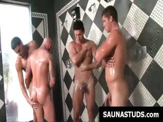 Boys in the sauna get all oiled up...