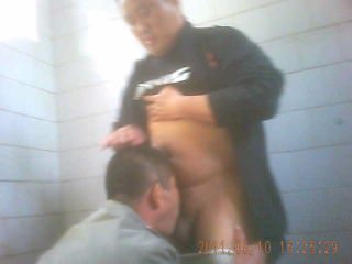 chinese bear gets bj in pubic toilet