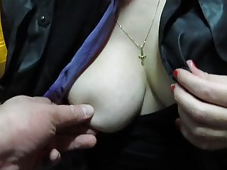 Touching her tits and pussy in a bus