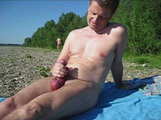 wank outdoors in public at the beach