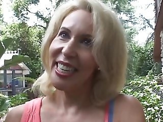 Blonde mature in a bright ass session