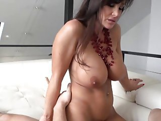 Amazing Brunette  Pornstar Riding Silicone Tits