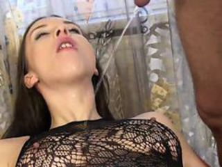 Dark haired amateur in pantyhose sucks the piss from her