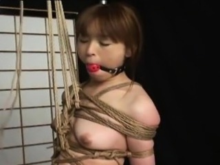 Tied up Asian in perfect rope knots treated to bdsm innings