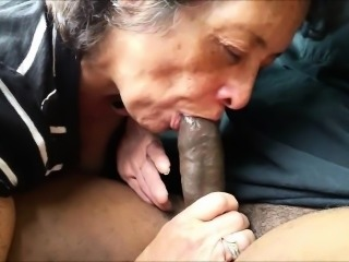 Amateur Granny eating a swart dick