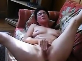 Scalding Granny Rubs Her Clit Coupled with Pussy