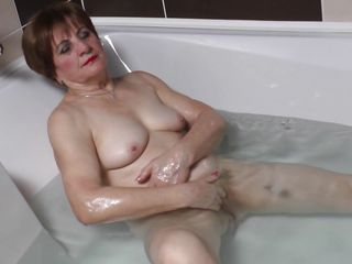 Watch this horny 70 years old lady masturbating all alone while taking a bath. She is all naked, showing her chubby body and saggy tits. And in the tub water this horny granny starts touching herself like a horny whore. See how she is rubbing her clitoris and then fingers her vagina for satisfaction.