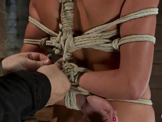 She's a slut and her body is tied up hard. They are going to teach her a hard lesson about sex and after she grabbed by the head and putted to lick that busty brunette ass this chick receives a hard dick in her mouth. She swallows the cock without objections and then starts licking the balls too. Want to see how they will fuck her next?