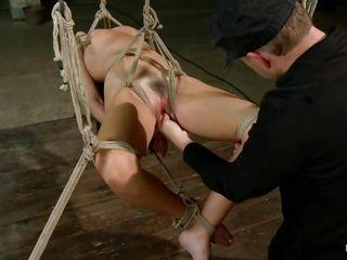 She has a glorious body and she had certainly never thought that her body will be used like that to give a sadistic pleasure to this man who seems to be hell bent on destroying her. He has tied her and left her hanging in the air to let her feel both the excruciating pain and the humiliation.