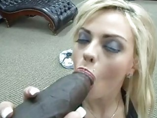 Busty blonde slut with back tattoo rides on black bazooka