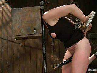 Horny slut Josi with her head in a box is all tied up and has metal clamps on her nipples. While standing, she spreads her legs because her female executor said so. Then, she sticks a vibrator on the whore`s clitoris and starts fingering that really wet shaved pussy. Wanna see how she gets her ass spanked?