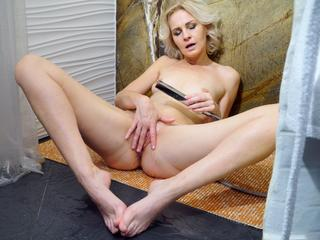 Mature blonde masturbating in the shower Sex Tubes
