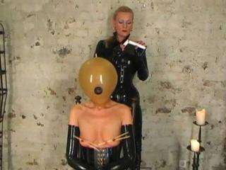 latex slave bird tortured by rubber mistress