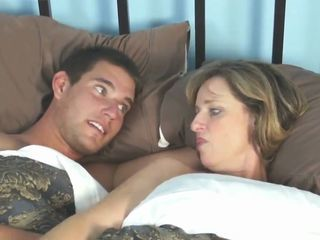mom and son ration bed in hotel when go travel