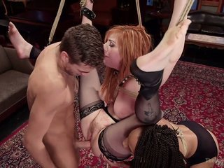 Swarthy mistress Nikki Darling and the brush adjunct fuck directed up red haired milf