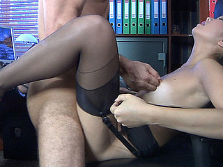 Exotic office hottie in six-strap garter nylons getting nailed on the desk